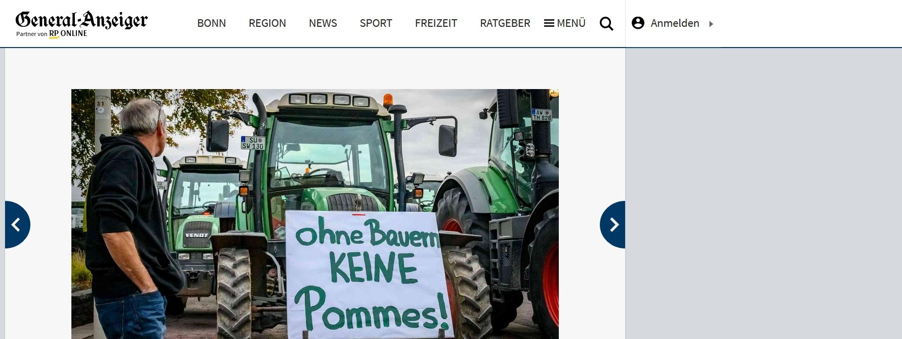 """Foto von Traktor mit Demoschild """"Ohne Bauern keine Pommes"""""""